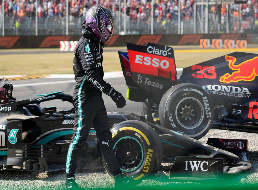 <p>Lewis Hamilton walks away from his Mercedes after colliding with Max Verstappen (Luca Bruno/AP)</p>