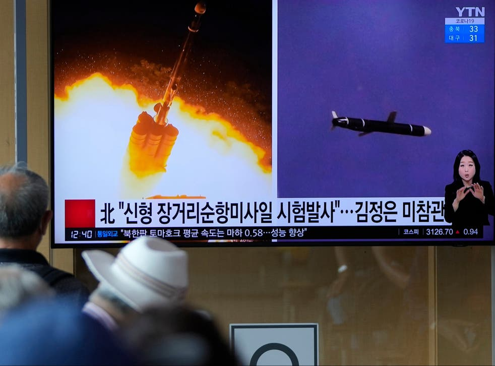 <p>File: People watch a TV screen showing a news programme reporting about North Korea's long-range cruise missiles tests</p>
