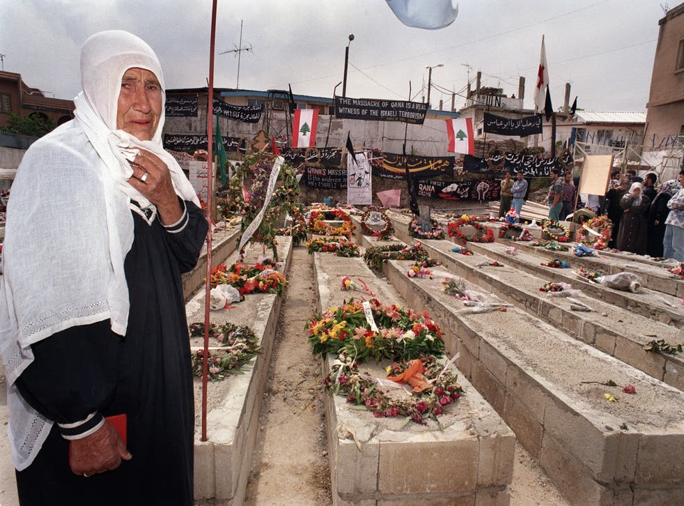 <p>A Lebanese woman by the graves of the 105 civilians killed when Israeli artillery shelled the UN compound in Qana during Israel's 'Grapes of Wrath' offensive</p>