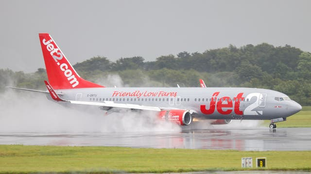 <p>A Jet2 Boeing 737 touches down at Manchester Airport</p>