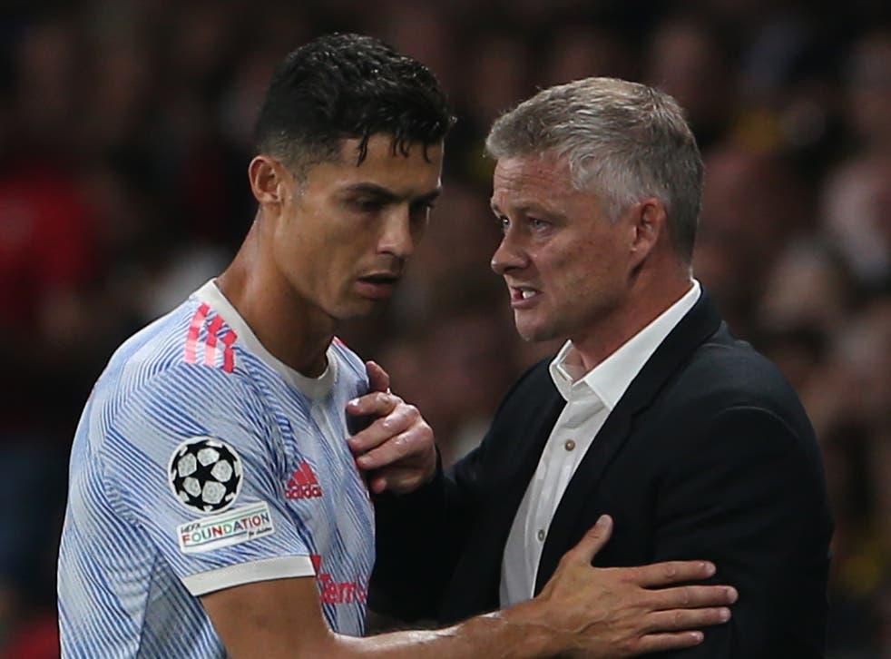 <p>Manchester United's Cristinao Ronaldo and Ole Gunnar Solskjaer</p>