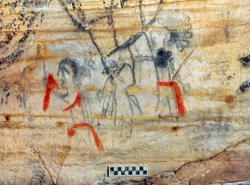 <p>This undated photo provided by Alan Cressler shows a Missouri cave featuring artwork from the Osage Nation more than 1,000 years old </p>