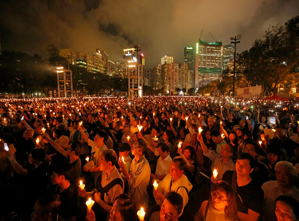 <p>File Thousands of people attended a candlelight vigil for victims of the Chinese government's brutal military crackdown three decades ago on protesters in Beijing's Tiananmen Square at Victoria Park in Hong Kong in 2019 </p>