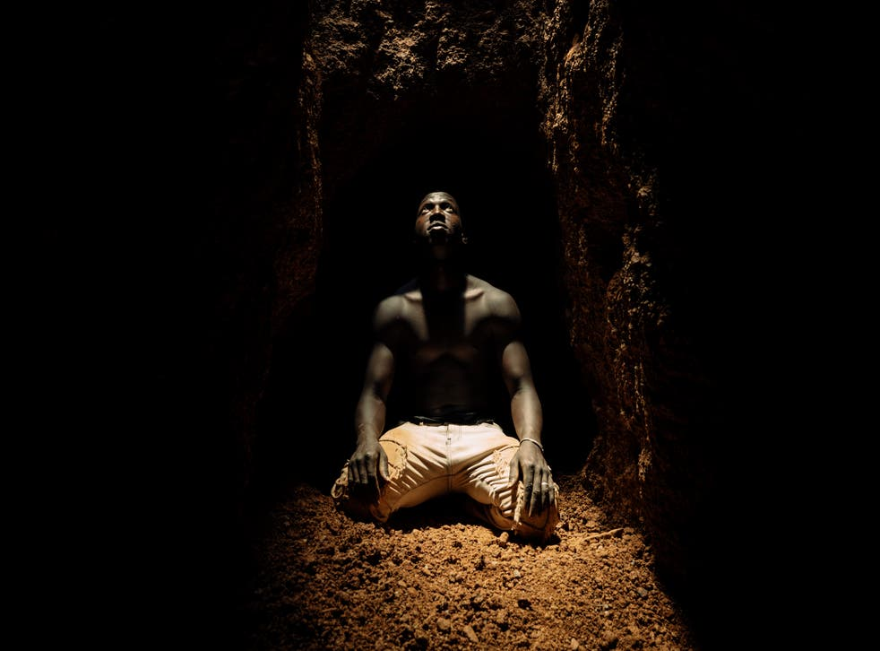 <p>A miner kneeling at the bottom of a deep shaft catches his glimpse of daylight before retreating along a tunnel which extends as far as 200 metres</p>