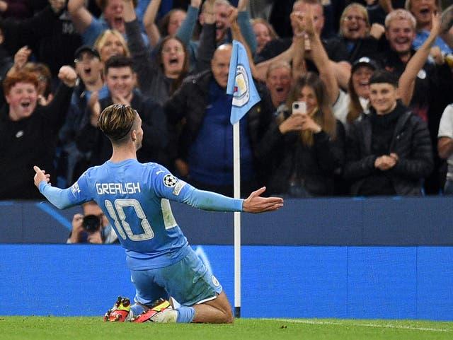 <p>Manchester City's Jack Grealish celebrates scoring against RB Leipzig</p>