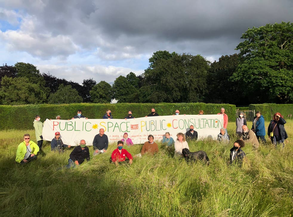<p>Protesters assemble at the meadow in Heigham Park in July</p>
