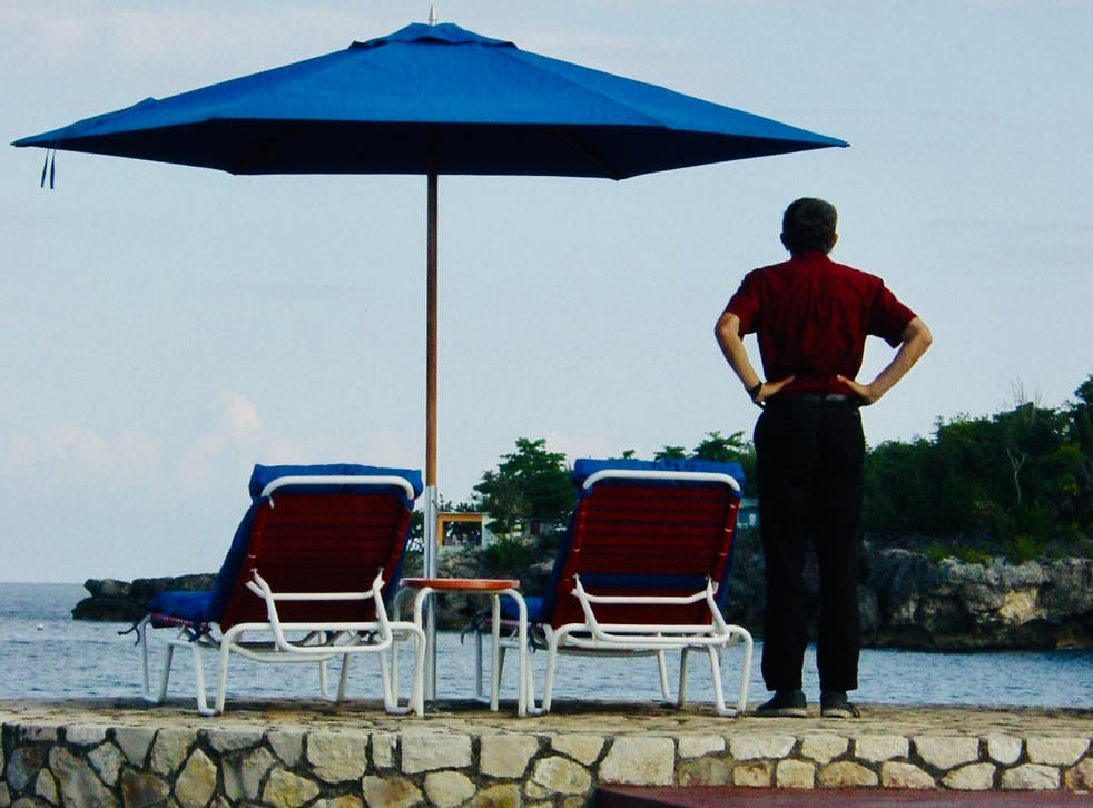 <p>Where's that helicopter? Simon Calder poolside in Negril, Jamaica</p>