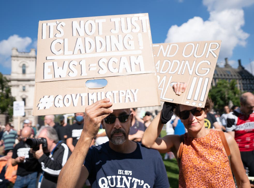 <p>Protesters from Leaseholders Together gather at rally in Parliament Square, Westminster</p>