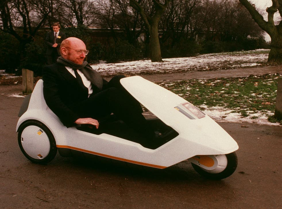 <p>Sir Clive Sinclair demonstrates his battery-assisted pedal powered tricycle on January 10, 1985 in Alexandra Palace, London</p>
