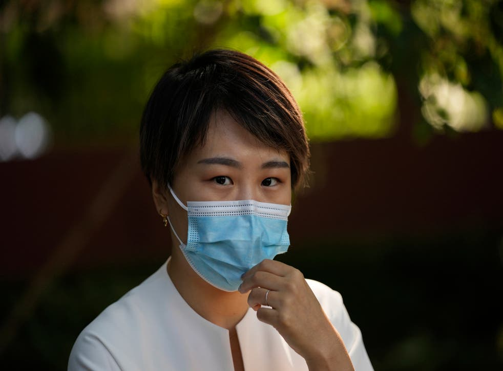 <p>Teresa Xu prepares to attend a court session at the Chaoyang People's Court in Beijing</p>