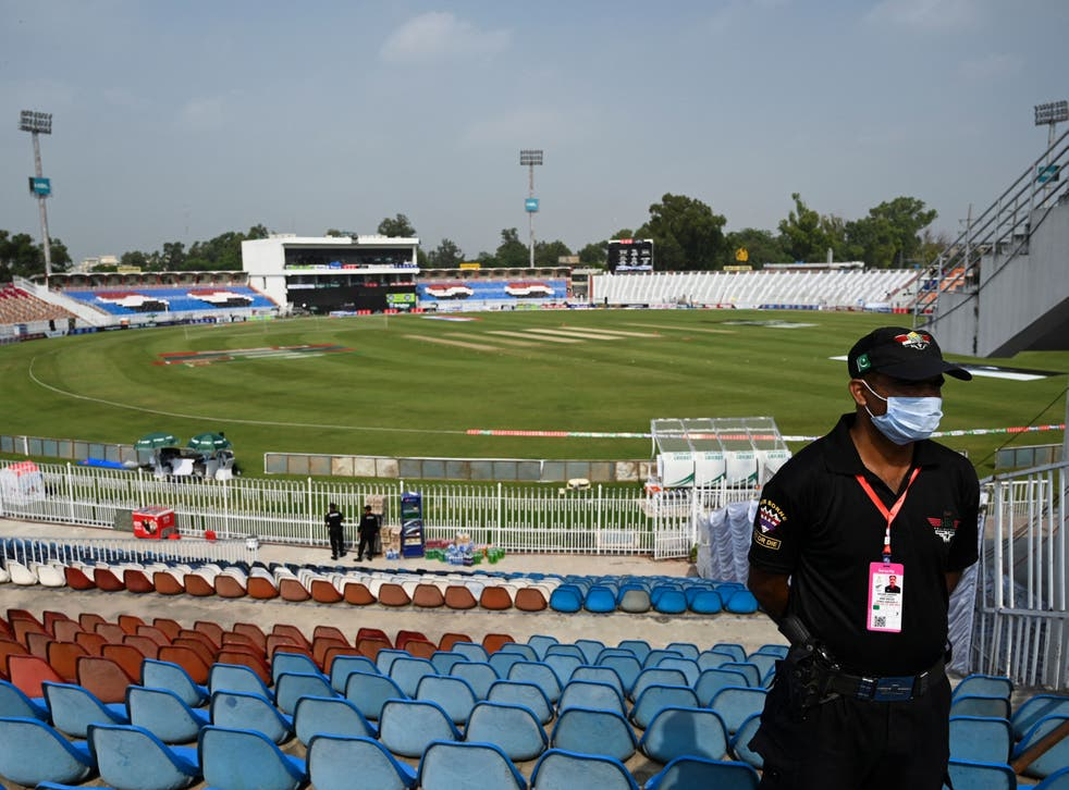 <p>A policeman stands guard on the empty stands of the Rawalpindi Cricket Stadium in Rawalpindi</p>