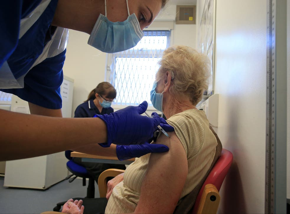 <p>A nurse at a GP practice in Haxby vaccinates an elderly patient </p>
