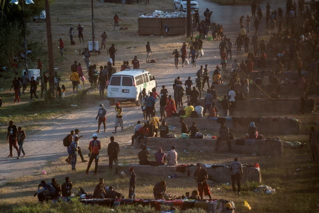 <p>Migrants seeking asylum in the U.S. rest near the International Bridge between Mexico and the U.S. as they wait to be processed, in Del Rio, Texas</p>