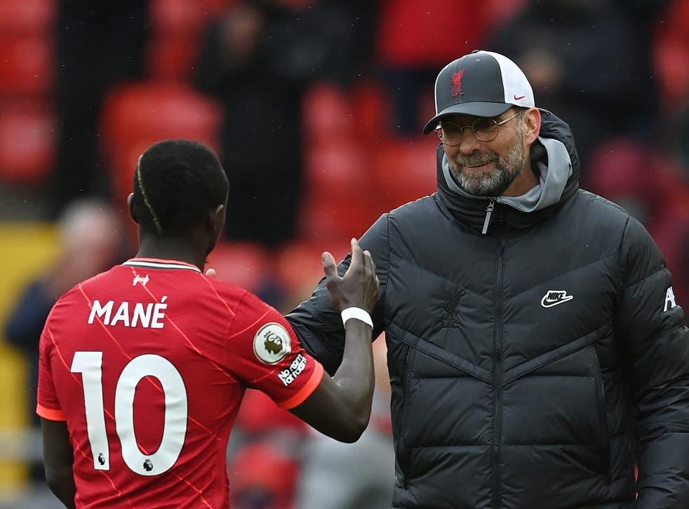 <p>Liverpool forward Sadio Mane with coach Jurgen Klopp</p>
