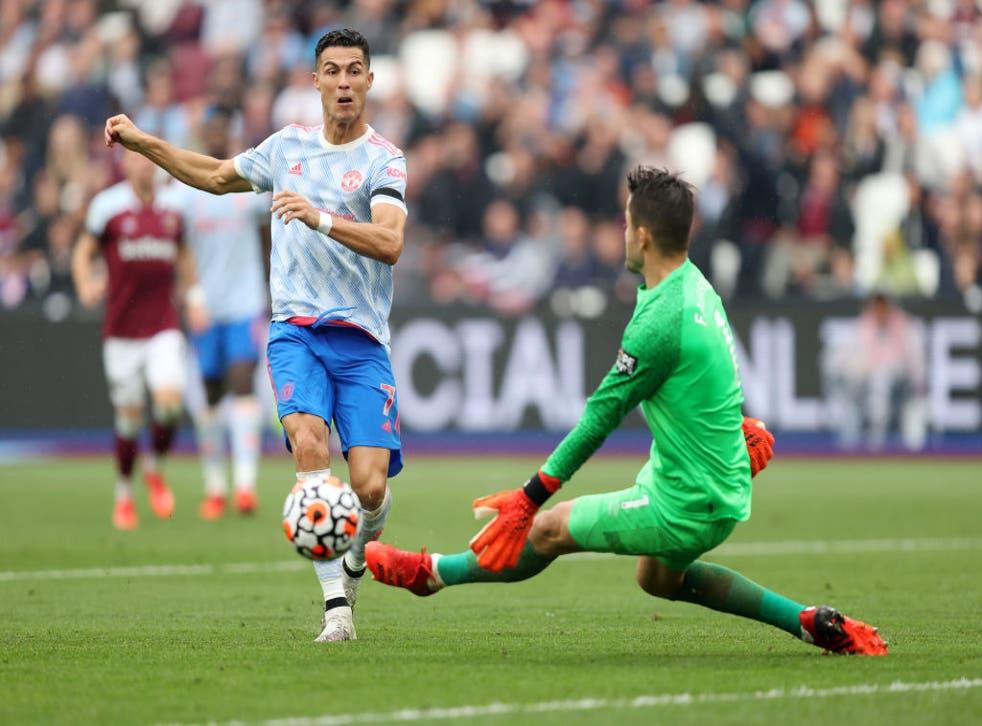 <p>Cristiano Ronaldo sees his shot saved by Lukasz Fabianski </p>