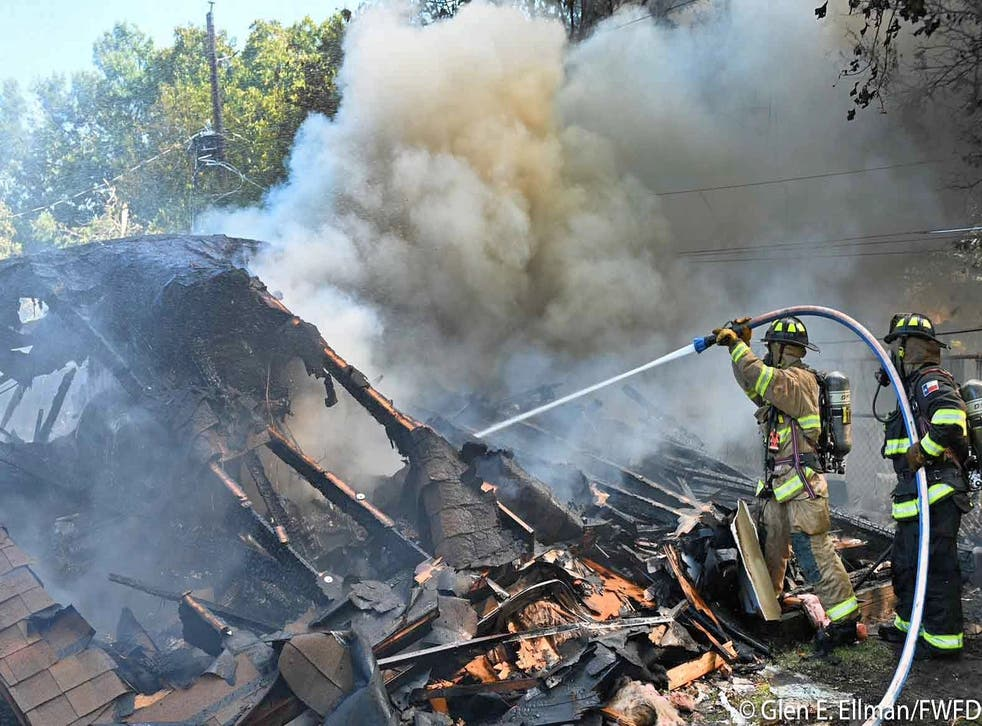 <p>Two Navy pilots were injured after ejecting as their plane crashed in the North Texas neighbourhood of Lake Worth</p>
