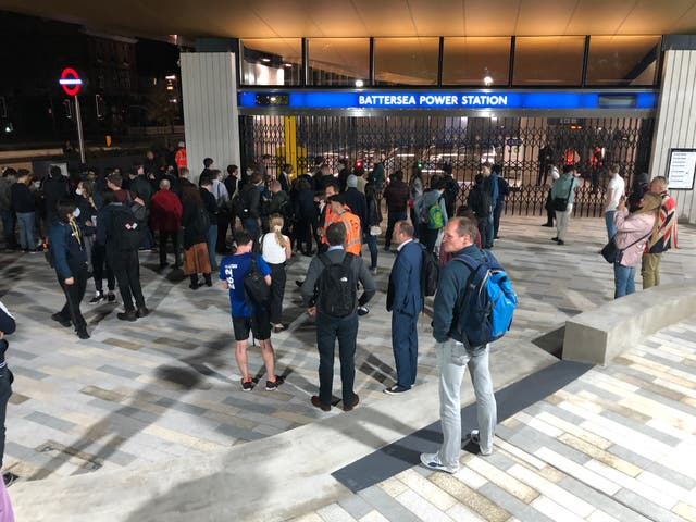<p>Tube enthusiasts waiting for the opening of the first new terminus on the London Underground this century</p>