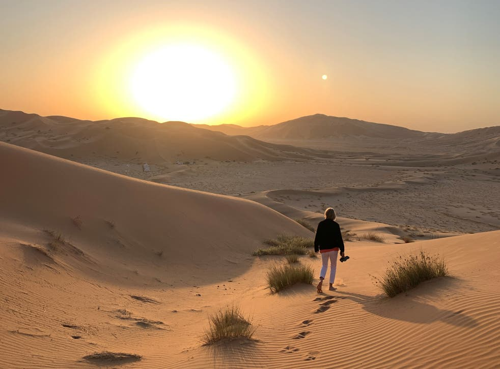 <p>Shoes go first: A fellow member of the tour group stretches her toes in the desert sand </p>