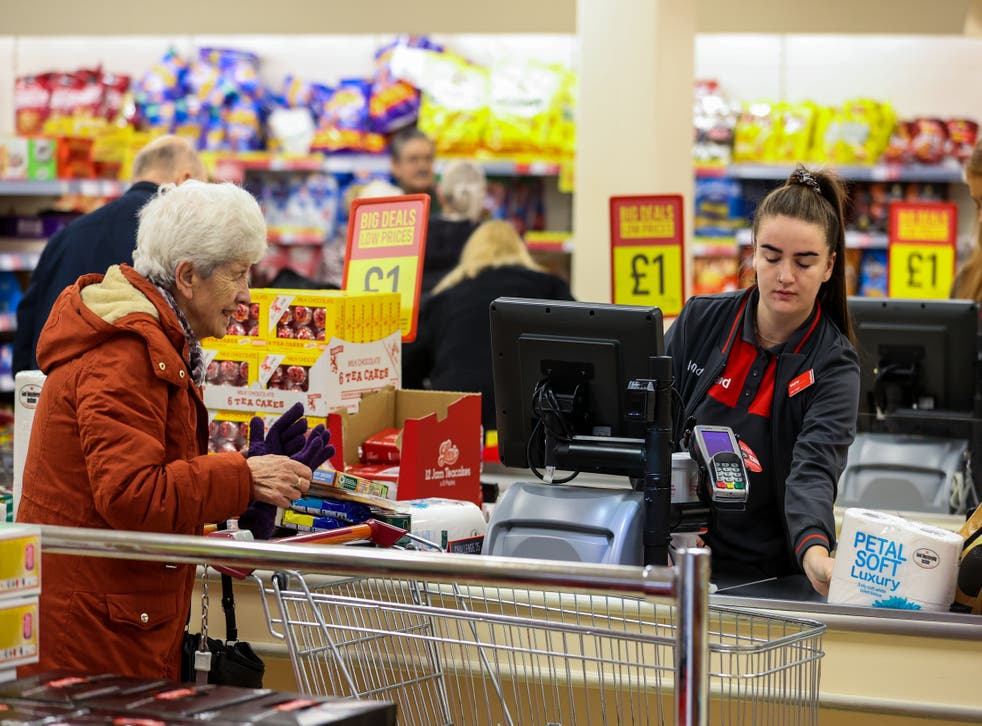 Elderly shoppers pay for their shopping at a branch of Iceland (Liam McBurney/PA)