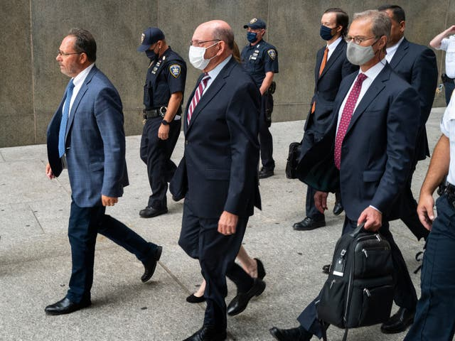 <p>The Trump Organization's Chief Financial Officer Allen Weisselberg, center, leaves after a courtroom appearance in New York, Monday, Sept. 20, 2021</p>
