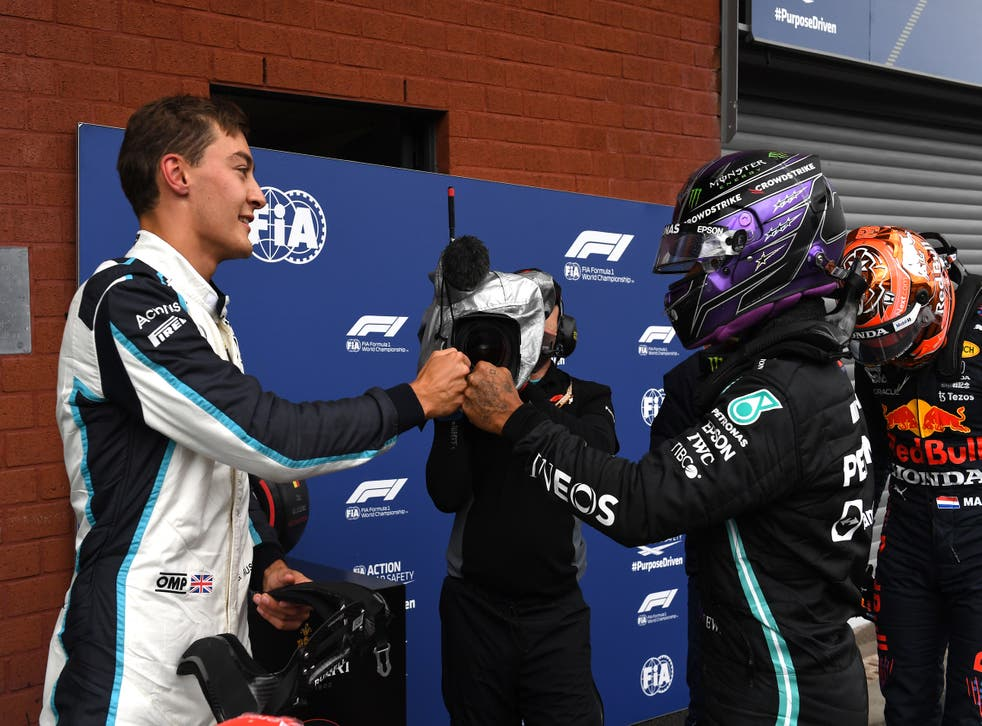 <p>George Russell (left) will drive alongside Lewis Hamilton at Mercedes next year </p>