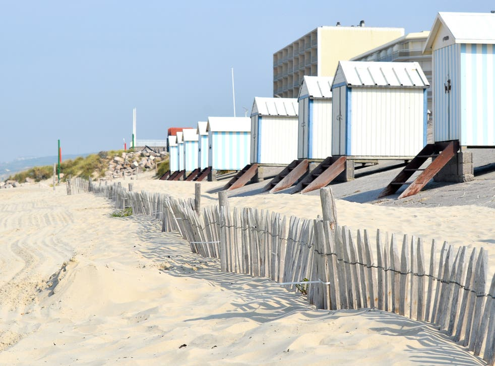 <p>Beach huts on the white sand at Hardelot near Le Touquet  </p>