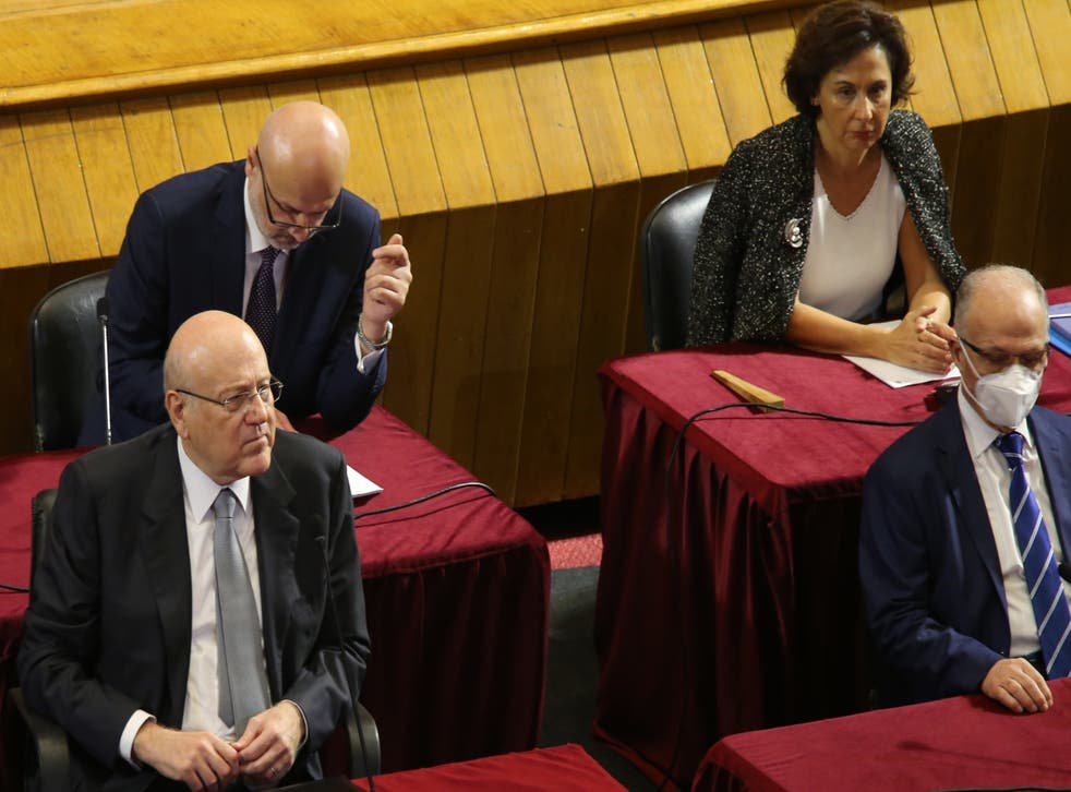 <p>Najib Mikati (left) speaks at the Unesco Palace in Beirut on 20 September. The session, to approve the new cabinet, was interrupted by a power outage </p>