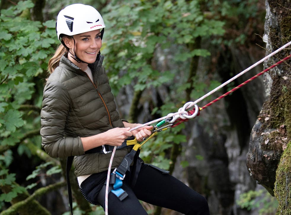 <p>Britain's Catherine, Duchess of Cambridge, uses abseiling gear as she visits Royal Air Force (RAF) Air Cadets at their Windermere Adventure Training Centre near Ambleside in north west England</p>