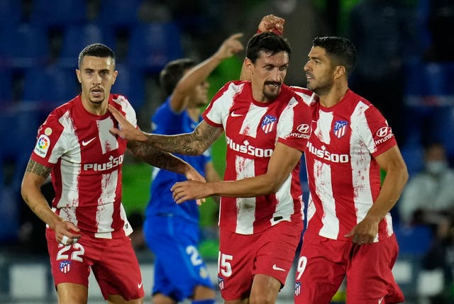 Luis Suarez scored twice to sink Getafe (Manu Fernandez/AP)