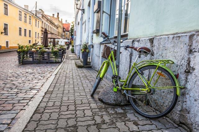 Cycling through Tallinn, Estonia (Alamy/PA)