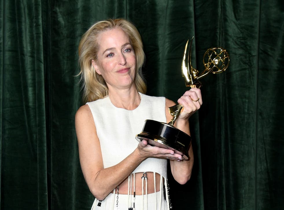 <p>Gillian Anderson holds her Emmy for Outstanding Supporting Actress for a Drama Series on 19 September 2021</p>