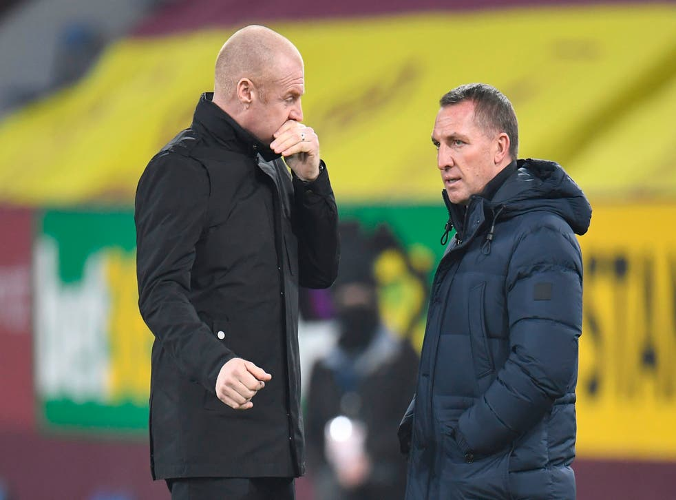 <p>Sean Dyche (left) and his Burnley side take on Brendan Rodgers' Leicester City </p>