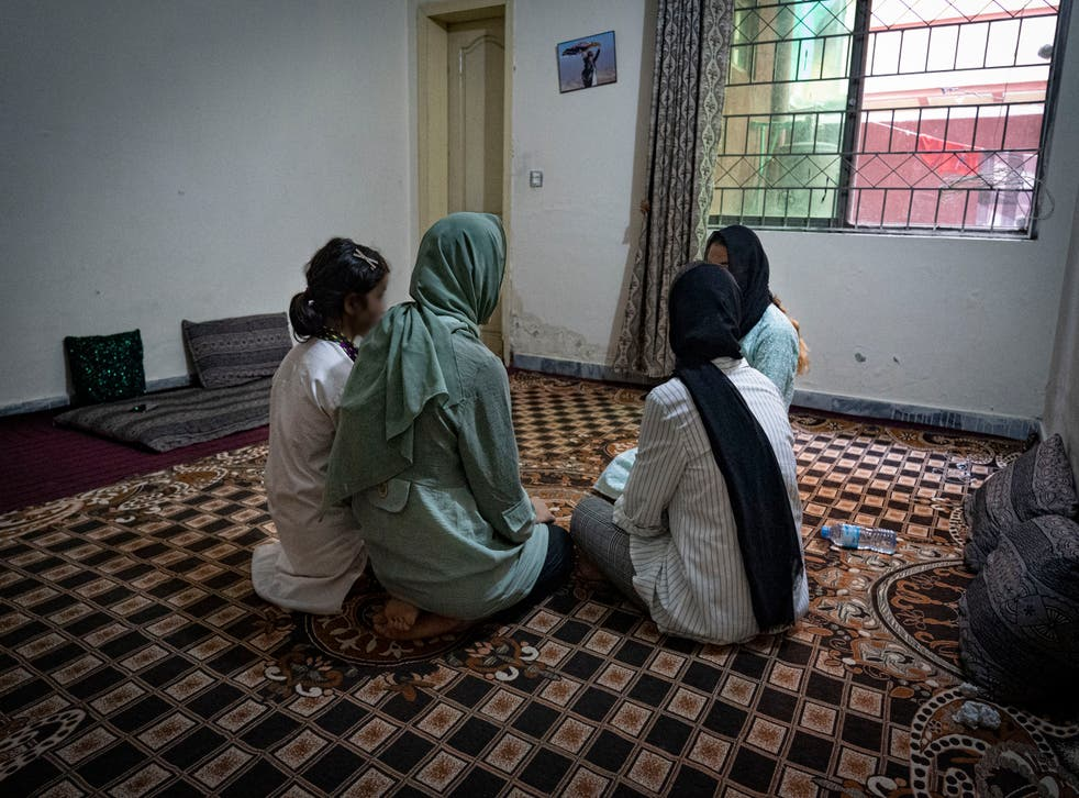 <p>Sima and her sisters in an apartment block outside Islamabad</p>