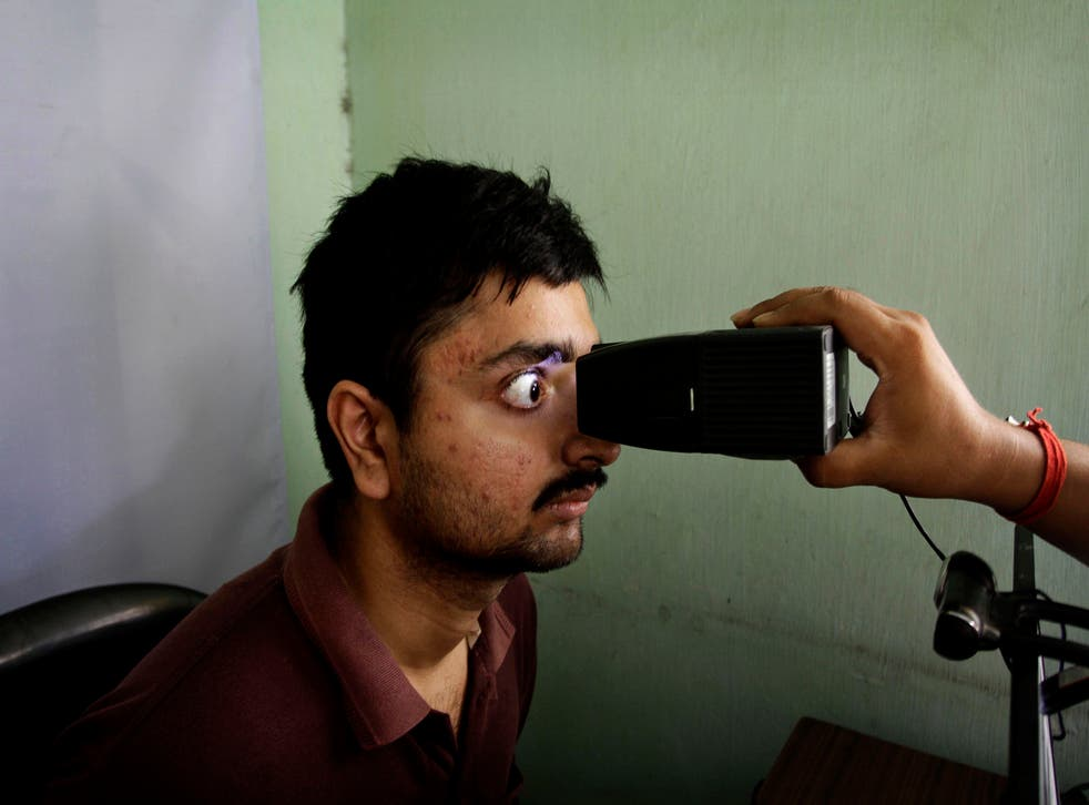 <p>An Indian man gets his retina scanned to register for Aadhar, India's unique identification project, in Calcutta. The agency responsible for India's national identification database is among the organisations to have been hacked</p>