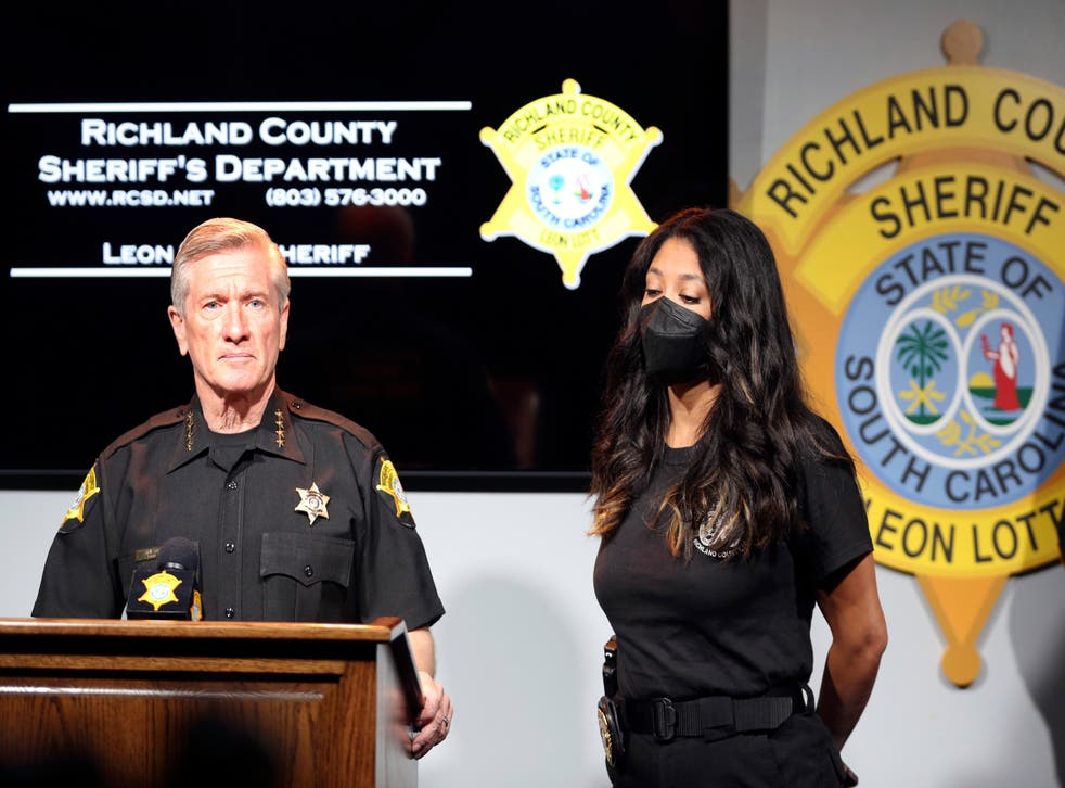 <p>Richland County Sheriff Leon Lott, left, and Coroner Nadia Rutherford, right, talk about the heat deaths of two 20-month-old twin boys during a news conference on Tuesday 21 September 2021, in Columbia, South Carolina. </p>