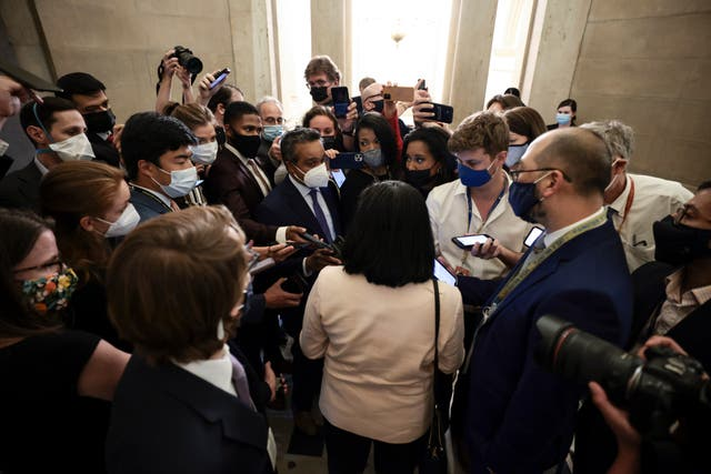 <p>Rep Pramila Jayapal (D-WA) is swarmed by reporters after a meeting with House Speaker Nancy Pelosi(D-CA) in her office in the U.S. Capitol Building on September 21, 2021 in Washington, DC</p>