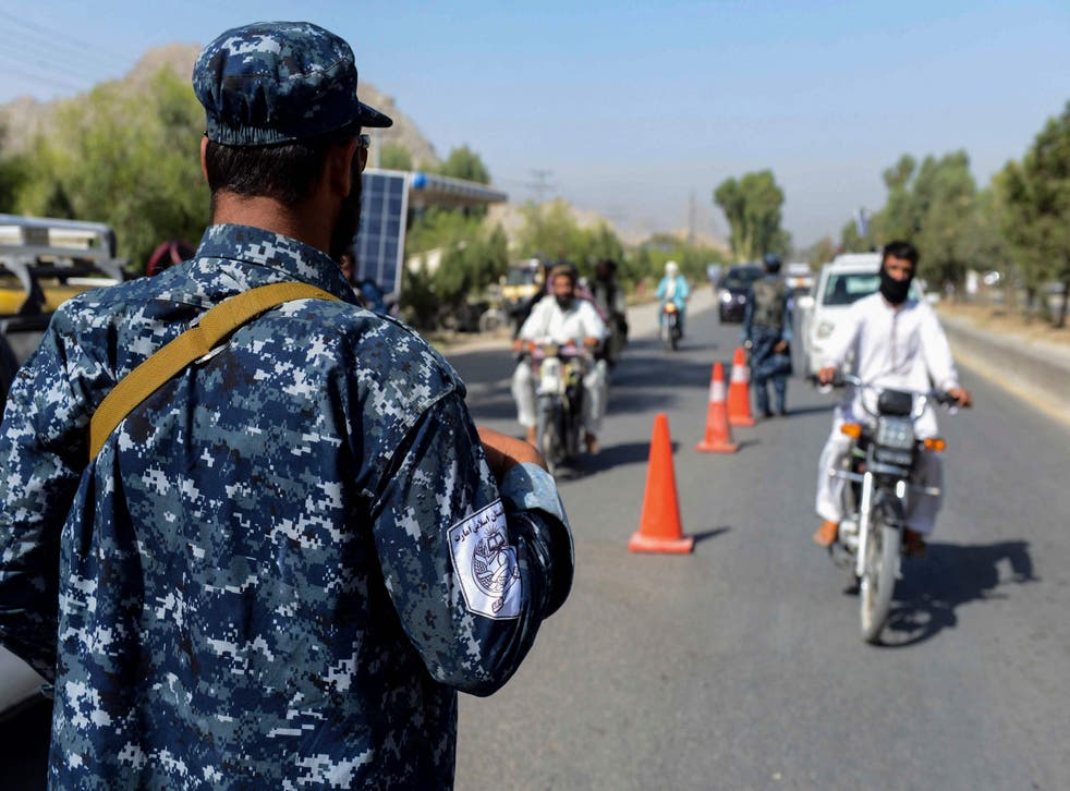 <p>A Taliban fighter is shown at a checkpoint in Kandahar on 21 September, 2021. </p>