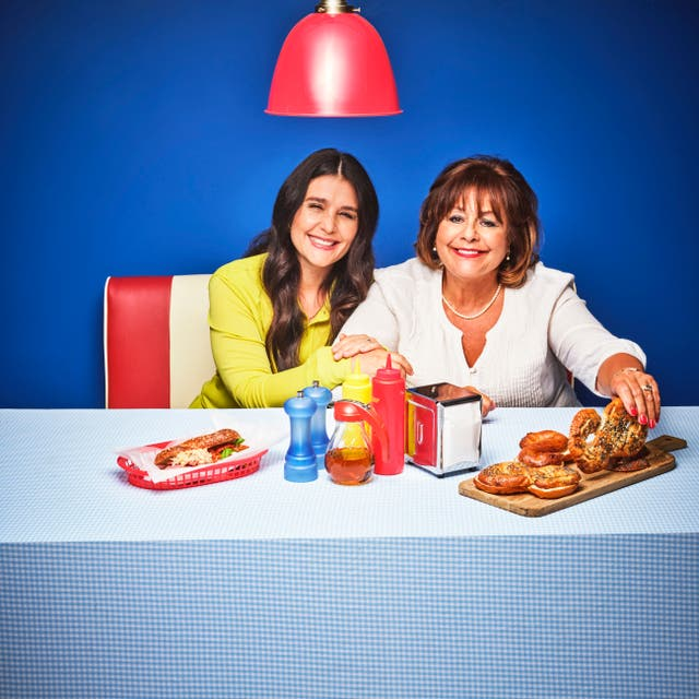 Jessie and Lennie Ware enjoy Twist & Share Bagels, designed to celebrate the British Airways American Express® Cards Companion Voucher benefit which could entitle you to a second seat for a companion when you make a Reward Flight booking (Handout/PA)