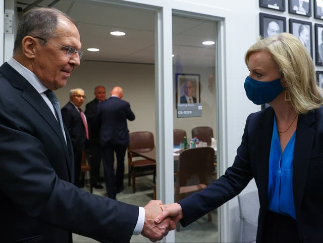 <p>Russia's Foreign Minister Sergei Lavrov shakes hands with Britain's Foreign Secretary Liz Truss during a meeting on the sidelines of the 76th Session of the United Nations General Assembly on 22 September 2021</p>