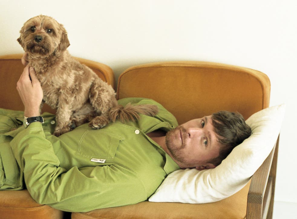 <p>Blake pictured with his beloved poodle mix, Barold </p>