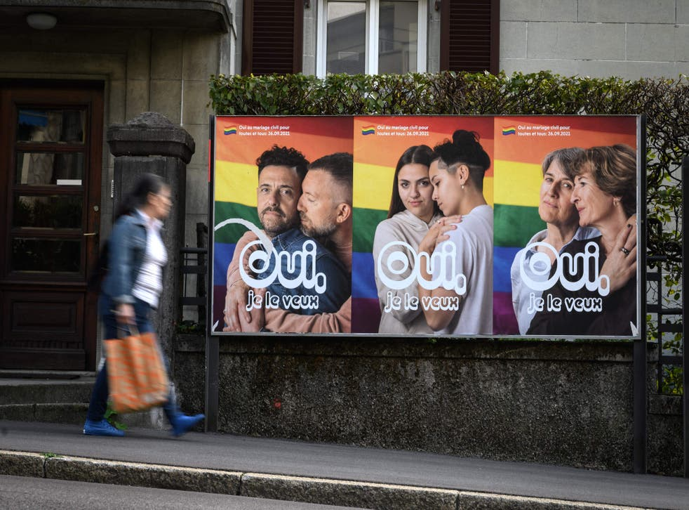 <p>A woman walks past an electoral poster in the town of Lausanne, Switzerland ahead of a nationwide vote on  same-sex marriage  </p>