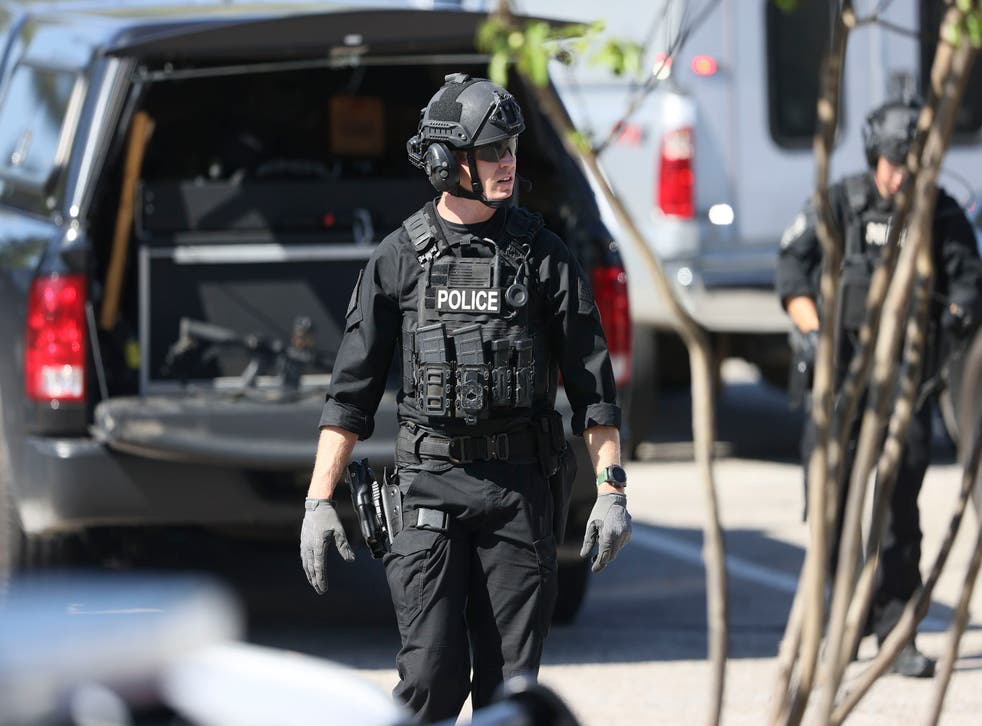 <p>Police respond to the scene of a shooting at a Kroger's grocery store in Collierville, Tennessee</p>