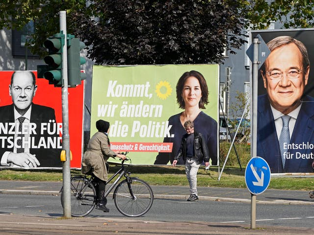 <p>Election posters for the three chancellor candidates, from right, the CDU's Armin Laschet, the Greens' Annalena Baerbock and the SPD's Olaf Scholz, in Gelsenkirchen</p>