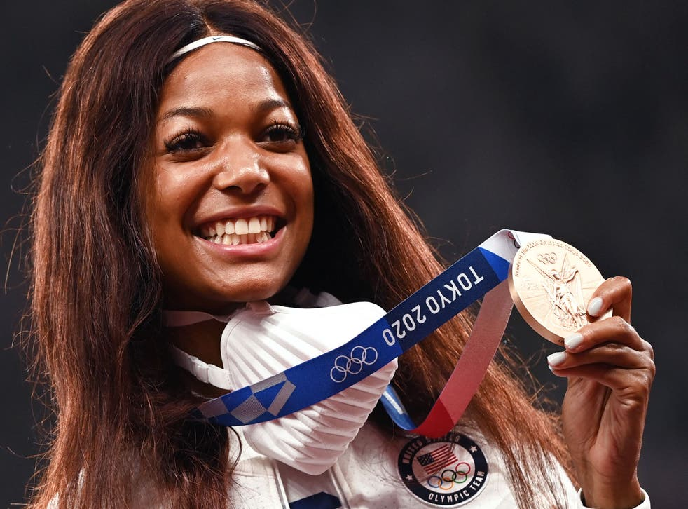 <p>Bronze medallist Gabby Thomas celebrates during the medal ceremony for the women's 200m event</p>