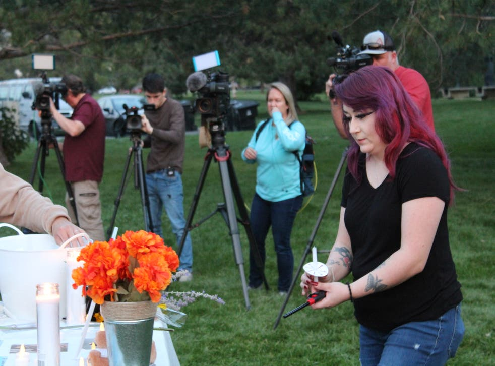 <p>Salt Lake City resident Serena Chavez lights a candle at the vigil she organized honoring Gabby Petito on Wednesday, Sept. 22.</p>