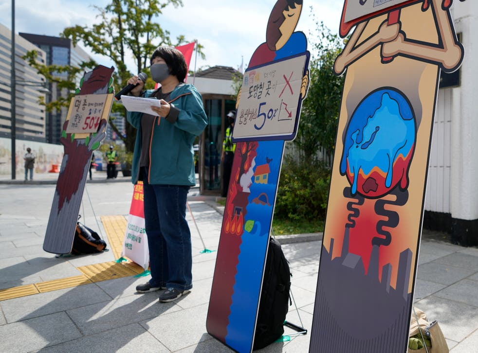<p>Young people take to the streets in South Korea on Friday to demand climate action </p>