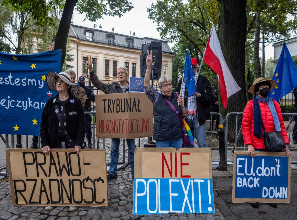 """<p>Demonstrators hold banners reading (from L) """"Rule of Law"""", """"Unconstitutional Court"""", """"No to Polexit"""" and """"EU don't Back Down"""" as they take part in a protest in August </p>"""