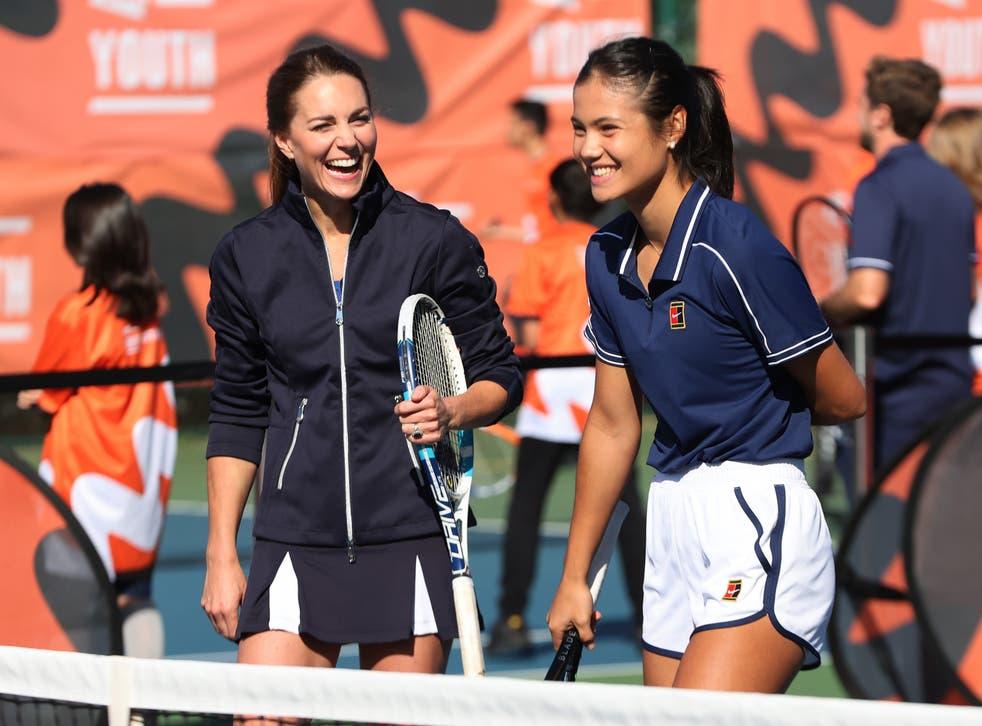 <p>Kate Middleton laughs as she plays tennis with Emma Raducanu (R)</p>