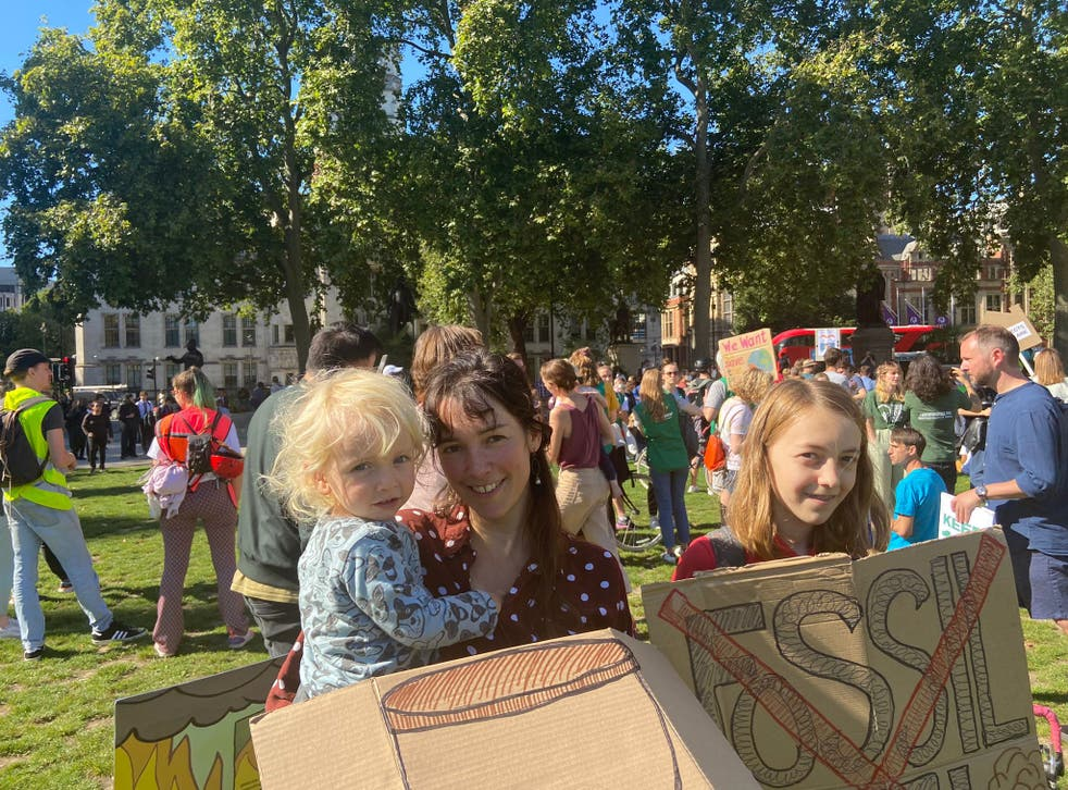 <p>Becky Truscott allowed her daughter May (R) to skip lessons in order to be at the protest</p>