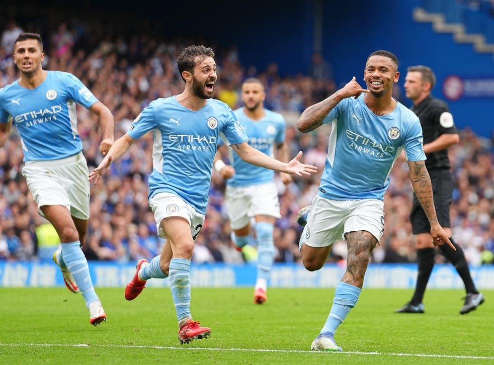 <p>Gabriel Jesus (right) celebrates scoring the winner </p>